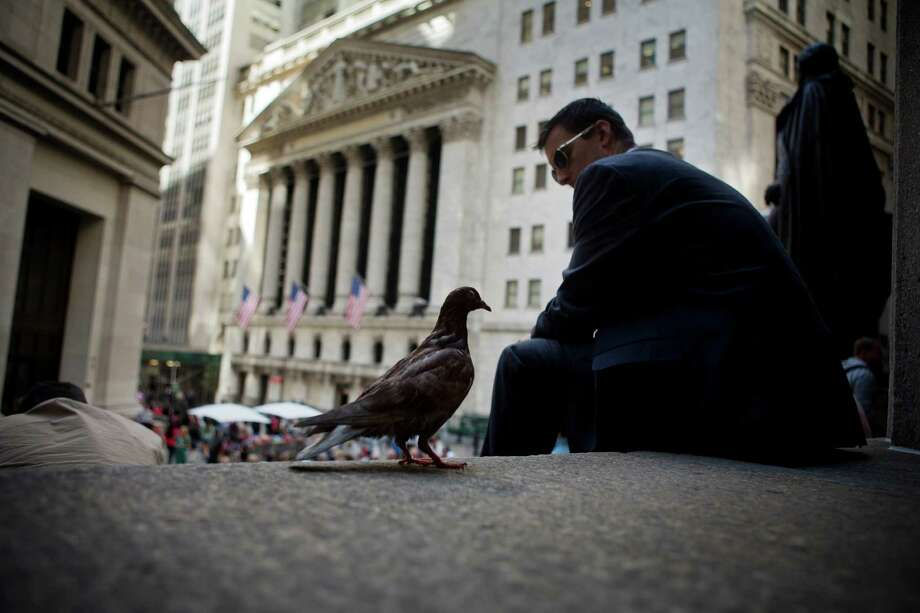 It can be peaceful on the steps of Federal Hall across from the New York Stock Exchange. But Wednesday was a difficult day inside the exchange as the Dow Jones industrial average fell more than 200 points.   Photo: Victor J. Blue / © 2014 Bloomberg Finance LP