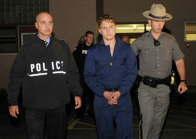 Shane Harding, 25, leaves North Greenbush Town Court after his arraignment on Wednesday, Oct. 1, 2014 in Wynantskill, N.Y. Harding, a registered sex offender raped a woman in Massachusetts, used a weapon to force her to drive him to North Greenbush and then ordered a man to drive him to Saratoga Springs where he was taken into custody Wednesday after a search that caused Skidmore College to order students to lock their doors. (Lori Van Buren / Times Union) Photo: Lori Van Buren / 00028864A