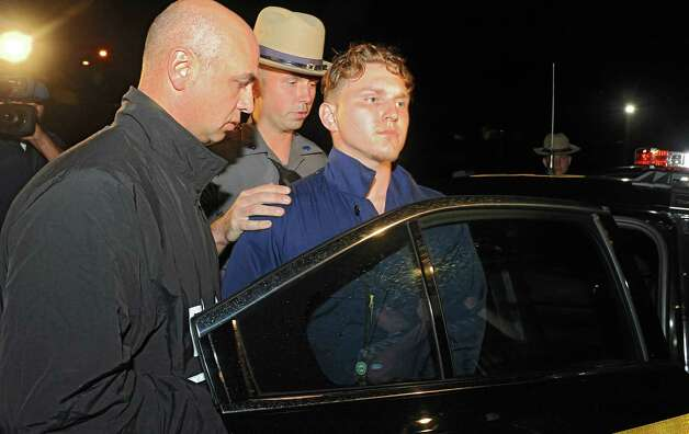 Shane Harding, 25, moments before putting up a struggle as the police put him in the state police car after his arraignment at North Greenbush Town Court on Wednesday, Oct. 1, 2014 in Wynantskill, N.Y. (Lori Van Buren / Times Union) Photo: Lori Van Buren / 00028864A
