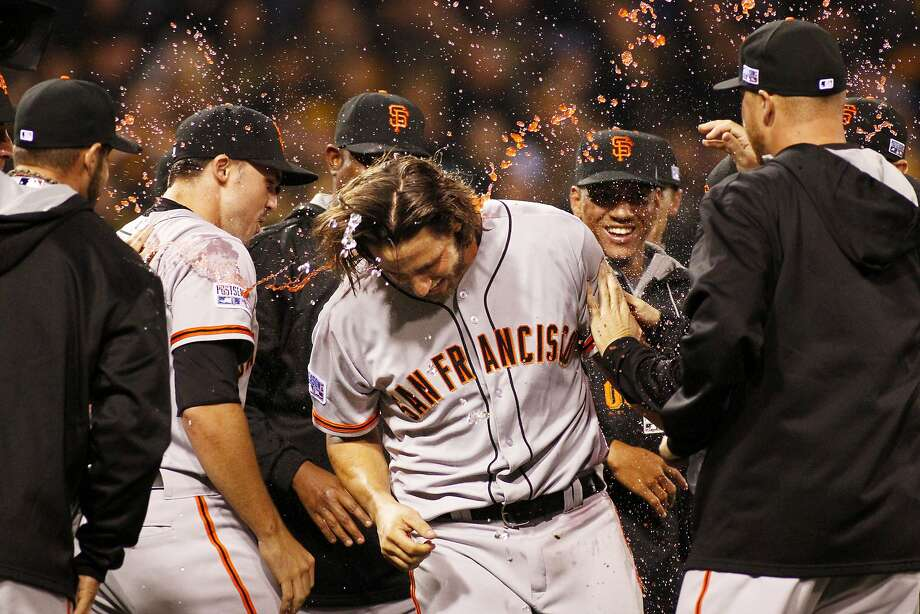 Madison Bumgarner #40 of the San Francisco Giants celebrates with teammates after the defeated the Pittsburgh Pirates 8 to 0 in the National League Wild Card game at PNC Park on October 1, 2014 in Pittsburgh, Pennsylvania. Photo: Justin K. Aller, Getty Images