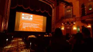 """Movie trivia and other slides play on the big screen at the Jefferson Theater before Friday's showing of """"Ferris Bueller's Day Off."""" The Jefferson Theater hosted a showing of """"Ferris Bueller's Day Off"""" for the kick off of Beaumont's Classic Movie Night series on Friday. The movie was the first of a run of 12 feature films to be shown at the historic theater. Photo taken Friday 8/15/14 Jake Daniels/@JakeD_in_SETX"""