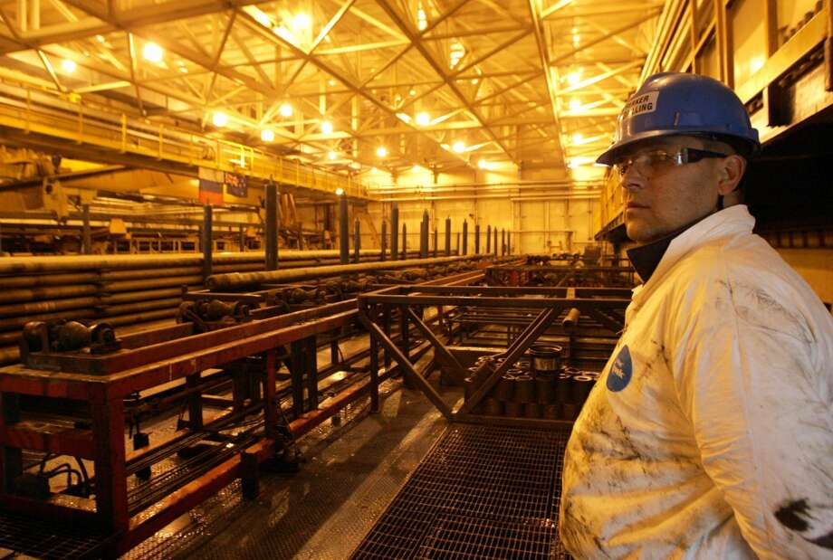 Recent cooperation between ExxonMobil and Rosneft began in 1996 with the Sakhalin-1 project. Located on Sakhalin Island, the largest in Russia, the $12 billion project broke the record in 2011 for the longest extended-reach well. In this photo, a worker stands in the oil-pipe depot at the Yastreb (Hawk) land rig at Sakhalin-1's Chaivo field. Photo: SERGEI KARPUKHIN, REUTERS