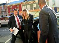 Melinda A. Wormuth, center, arrives for arraignment with representatives from the Attorney General's Office and the FBI on Wednesday, Oct. 17, 2013, at Waterford Town Court in Waterford, N.Y. (Cindy Schultz / Times Union)