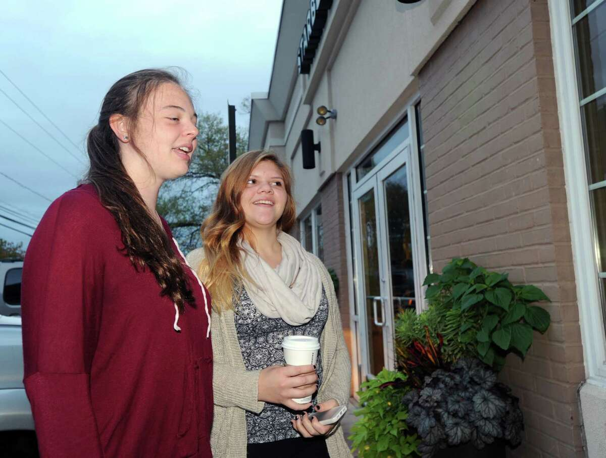 Greenwich High School seniors, Marie Claire Hamet, left, and Brianna Sanchez, speak with a Greenwich Time reporter about the early morning start time at Greenwich High School, while standing in front of the Cos Cob Starbucks, Greenwich, Conn., Thursday, Oct. 2, 2014.