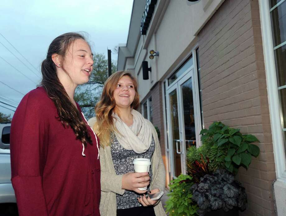 Greenwich High School seniors, Marie Claire Hamet, left, and Brianna Sanchez, speak with a Greenwich Time reporter about the early morning start time at Greenwich High School, while standing in front of the Cos Cob Starbucks, Greenwich, Conn., Thursday, Oct. 2, 2014. Photo: Bob Luckey / Greenwich Time