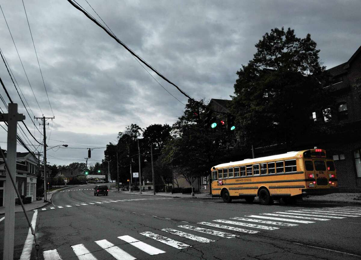 A school bus on East Putnam Avenue heads towards Greenwich High School in Greenwich, Conn., Thursday morning, Oct. 2, 2014.