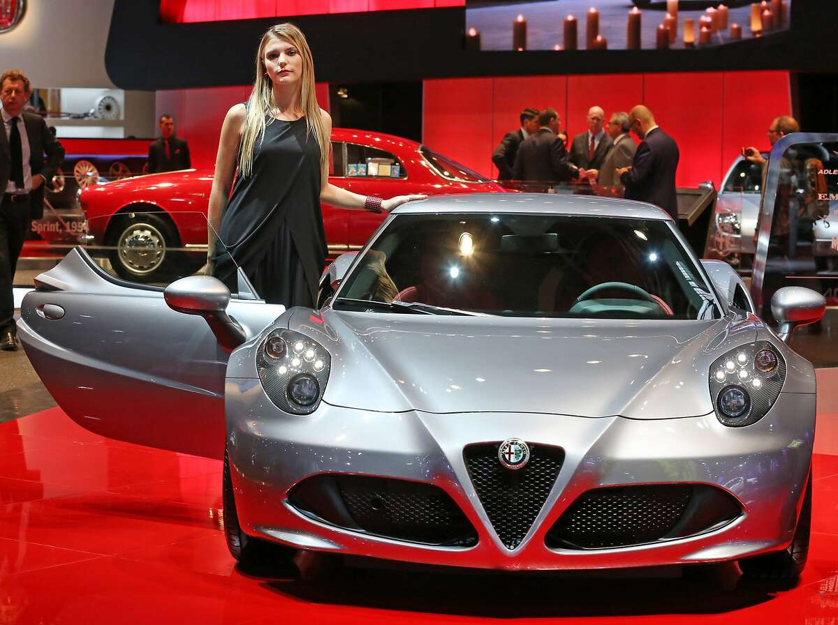 An Alfa Romeo 4C is presented at the Paris Motor Show.