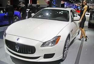 A Maserati Quattroporte GTS  is presented at the Paris Motor Show, in Paris, Thursday Oct. 2, 2014. The Paris Motor Show will open its doors to the public on Saturday Oct. 4, until Oct. 19.  European carmakers are hoping to impress with new models at this week's Paris Motor Show and prove they have come out stronger from years of economic trouble and cost-cutting. (AP Photo/Remy de la Mauviniere)