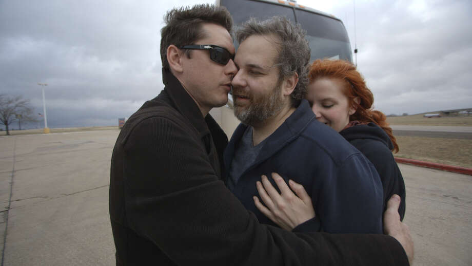 Podcast host Jeff Bryan Davis (left) and comic Erin McGathy (right) hug McGathy's fiance, tDan Harmon. Photo: Ryan Carmody / Future You Pictures / ONLINE_YES