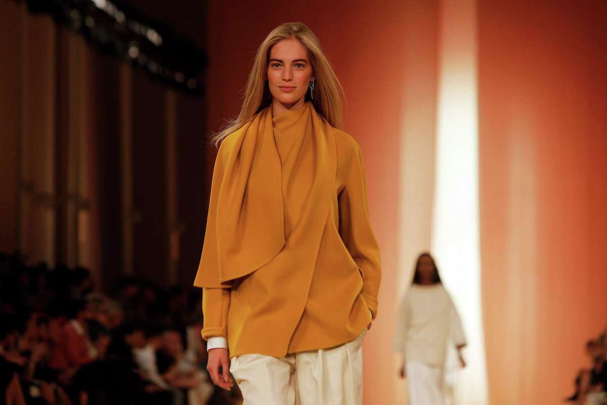 A model wears a creation as part of Hermes' Spring/Summer 2015 ready-to-wear fashion collection for Hermes, presented in Paris, France, Wednesday, Oct. 1, 2014. (AP Photo/Thibault Camus)