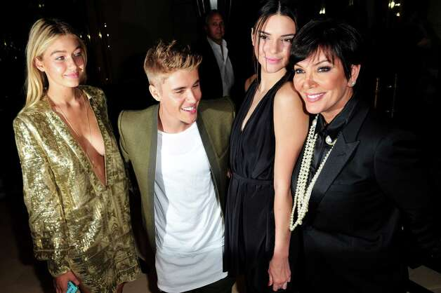 From left: Gigi Hadid, Justin Bieber, Kendall Jenner, and Kris Jenner pose for photographer at the Carine Roitfeld & Stephen Gan celebration of the launch of CR Fashion Book N.5 in Paris, Tuesday, Sept. 30, 2014.(AP Photo/Zacharie Scheurer) Photo: Zacharie Scheurer, STR / AP