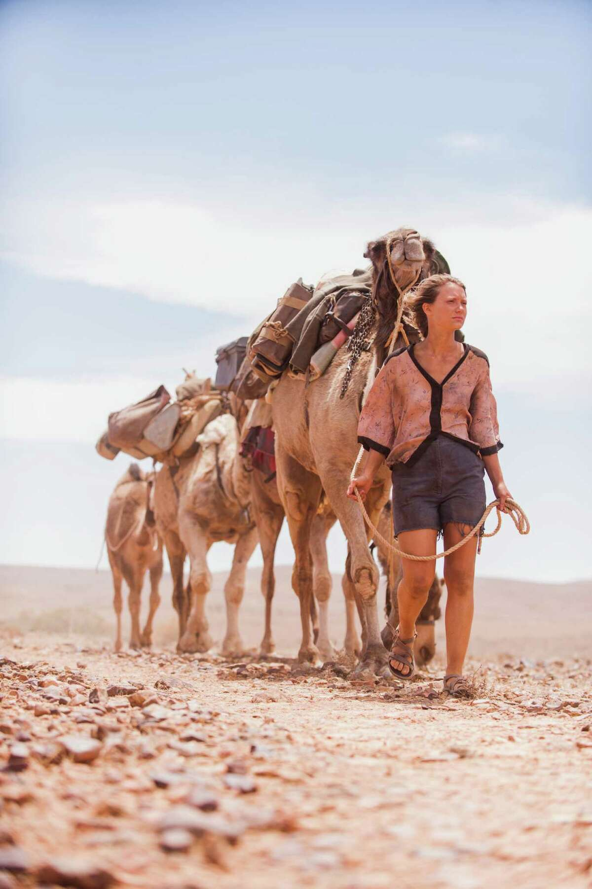 "Robyn (Mia Wasikowska) sets off on a solo journey across the desert in Australia in ""Tracks."""