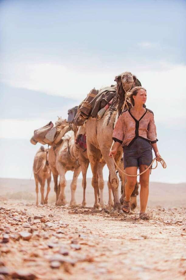 "Robyn (Mia Wasikowska) sets off on a solo journey across the desert in Australia in ""Tracks."" Photo: Matt Nettheim, HONS / The Weinstein Company"