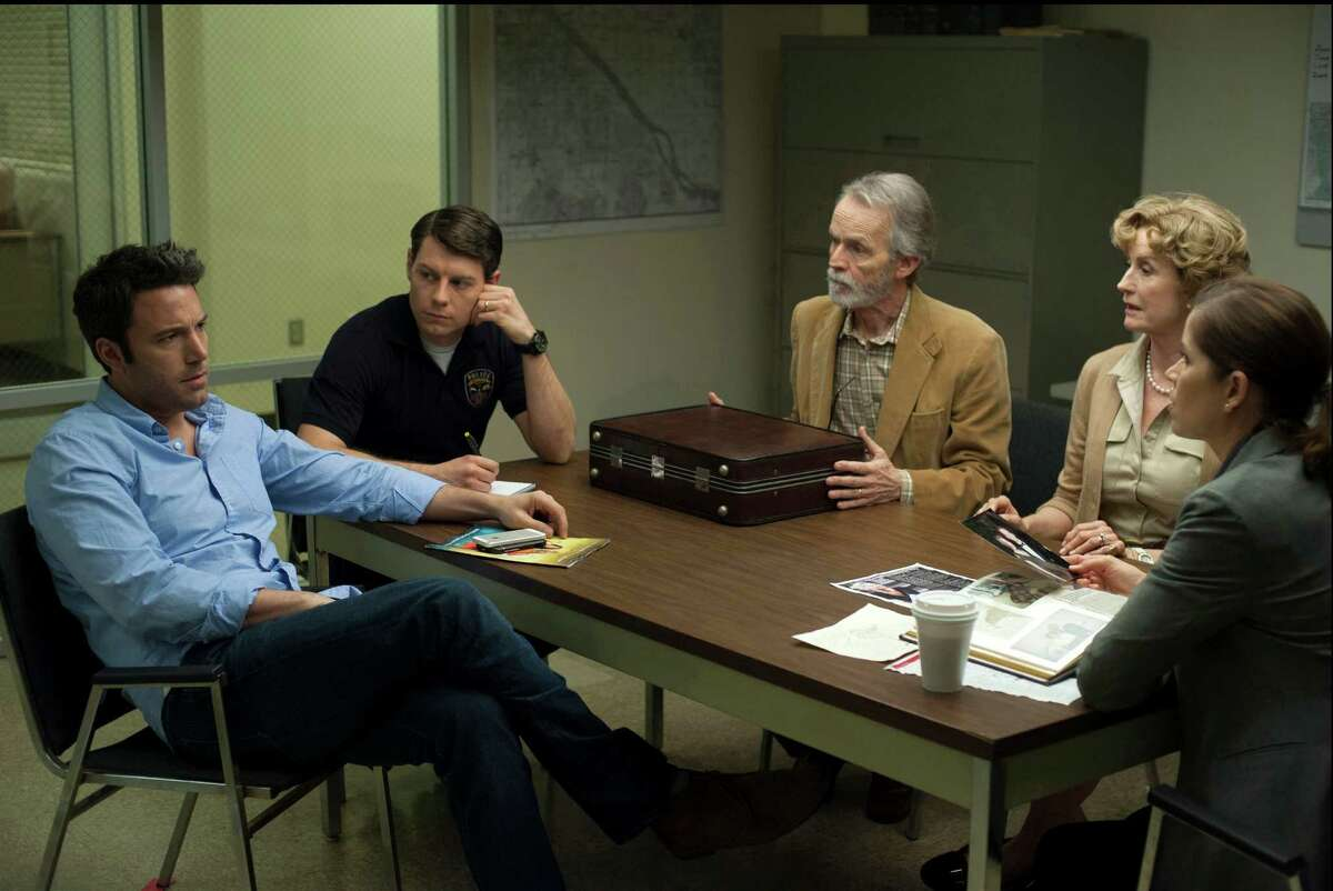 """This image released by 20th Century Fox shows, from left, Ben Affleck, Patrick Fugit, David Clennon, Lisa Barnes and Kim Dickens in a scene from """"Gone Girl."""" The film, based on the best-selling novel, will release on Oct. 3. (AP Photo/20th Century Fox, Merrick Morton)"""