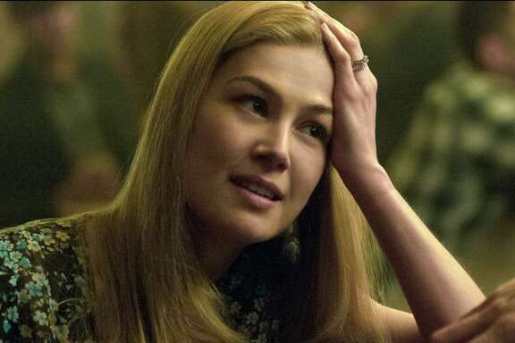 """Rosamund Pike stars in """"Gone Girl,"""" which hung on to the No. 1 spot at the box office for the second week."""