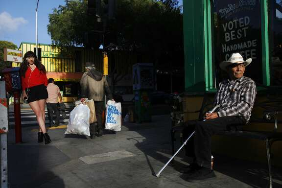 Longtime local resident Jose Luiz, 86, right, sits on a bench outside of the original Philz Coffee May 3, 2014 in San Francisco, Calif. In 2003, Phil started the coffee shop in a grocery store he already owned on the corner of 24th and Folsom. Since then, Phil has opened 15 more shops in and around the Bay Area.