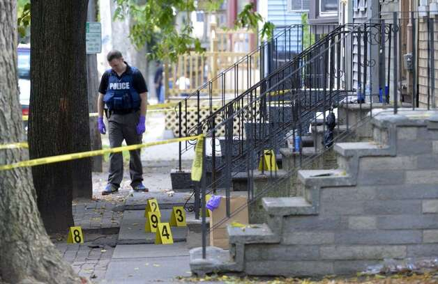 Evidence markers show the location of a shooting on First Street in Albany. (Skip Dickstein/Times Union)