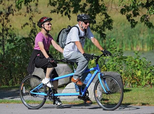 Richard and Dorothy Kover from Poughkeepsie ride their tandem bicycle on the Mohawk-Hudson Bike-Hike Trail on Thursday, Oct. 2, 2014 in Colonie, N.Y.   (Lori Van Buren / Times Union) Photo: Lori Van Buren