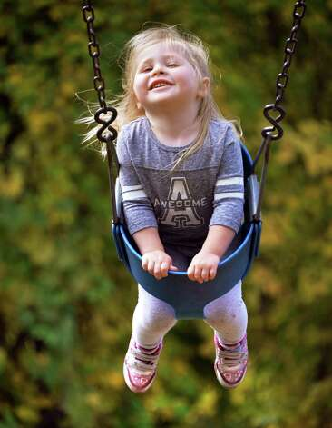 Andrea Del Re, 2 1/2, of Albany flies high on a swing set during a family outing at Six Mile Waterworks park Thursday Oct. 2, 2014, in Albany, NY.  (John Carl D'Annibale / Times Union) Photo: John Carl D'Annibale