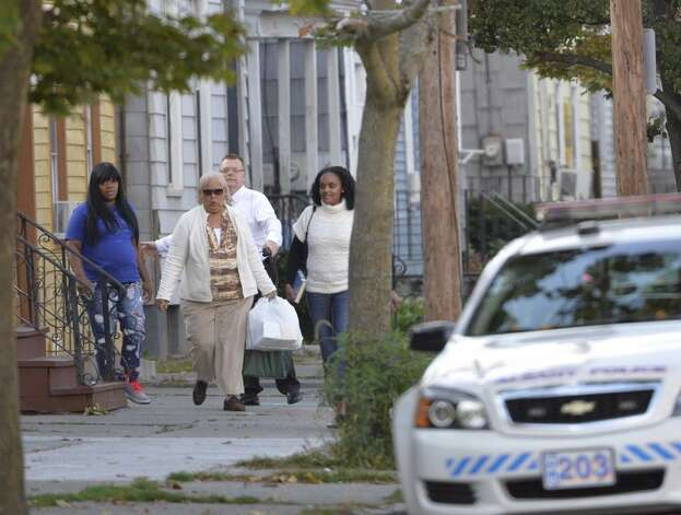 People are evacuated from a home across the street from a house surrounded by police on Clinton Avenue in Albany. (Skip Dickstein/Times Union)