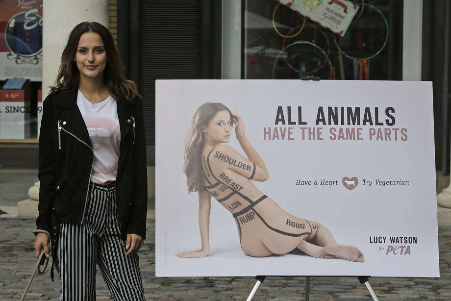 Alimentary, Watson:In London's Covent Garden, British actress Lucy Watson urgespeople to eat vegetables instead of meat as she standsnext to a PETA poster ofherself mimicking a butcher's diagram. Photo: Lefteris Pitarakis, Associated Press
