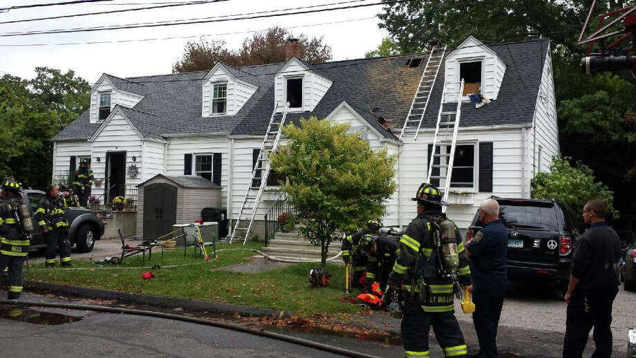 Firefighters on scene of a house fire on Adelaide Street Thursday afternoon. Photo: Genevieve Reilly / Fairfield Citizen