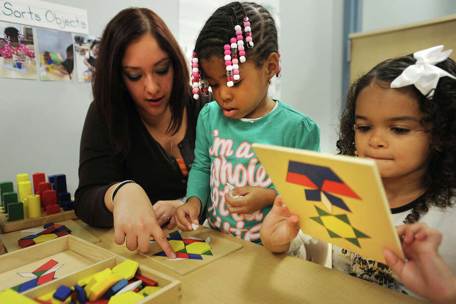 From left; Preschool teacher Lisa Kleemichen works with Maleeha Brown, 3, and Alexa Santiago, 4, at the newly expanded Cooperative Education Services School Readiness pre-K at 40 Lindeman Drive in Trumbull, Conn. on Thursday, October 2, 2014. Photo: Brian A. Pounds / Connecticut Post