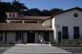 A man walks past the front of the newly redone Presidio Officers' Club Oct. 2, 2014 in San Francisco, Calif.