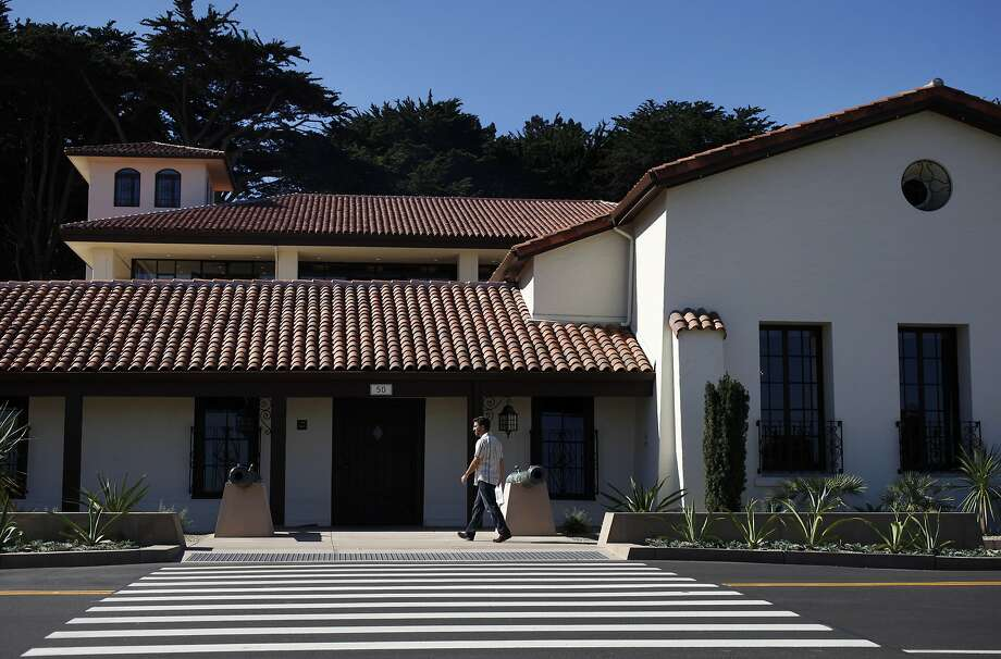 A man walks past the front of the newly redone Presidio Officers' Club Oct. 2, 2014 in San Francisco, Calif. Photo: Leah Millis, The San Francisco Chronicle