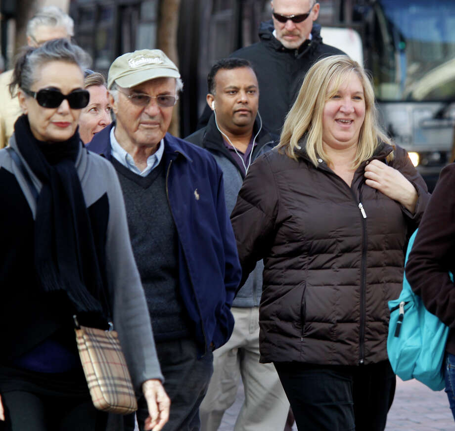 A woman smiled and laughed with a friend as she walked down Market Street. This month is Walktober, the month to celebrate walking here in San Francisco as well as across the globe. Photo: Brant Ward / The Chronicle / ONLINE_YES