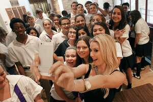 2006 Miss USA winner Tara Conner takes a picture with students giving a talk at Saint Mary's Hall about her life dealing with substance abuse on Thursday, Oct. 2, 2014. About 400 high school students listened as Conner talked about her challenges growing up, being crowned Miss USA and coming to terms with her drug and alcohol abuse. Her appearance was sponsored by Rise Recovery.