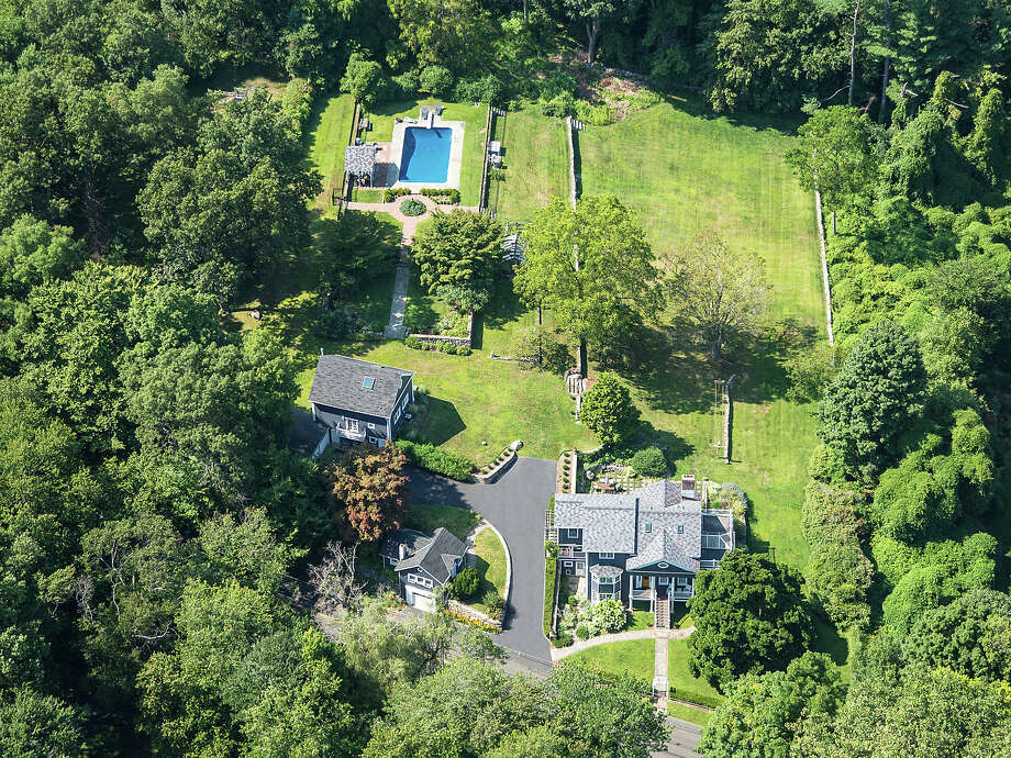 The property at 135 Comstock Hill Road is on the market for $1,999,000. Photo: Contributed Photo / New Canaan News
