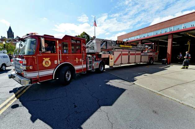 Albany Fire Department Ladder 1 returns to the South End Firehouse after a call Thursday afternoon, Oct. 2, 2014, in Albany, N.Y. (Skip Dickstein/Times Union) Photo: SKIP DICKSTEIN / 00028876A
