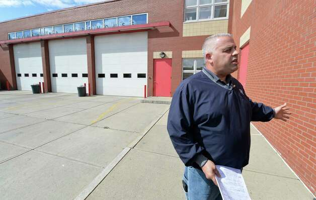 Albany Fire Fighters Union president Bob Powers discusses the possibility of taking Ladder 1 out of service Thursday afternoon, Oct. 2, 2014, ouside the South End Firehouse in Albany, N.Y.  (Skip Dickstein/Times Union) Photo: SKIP DICKSTEIN / 00028876A
