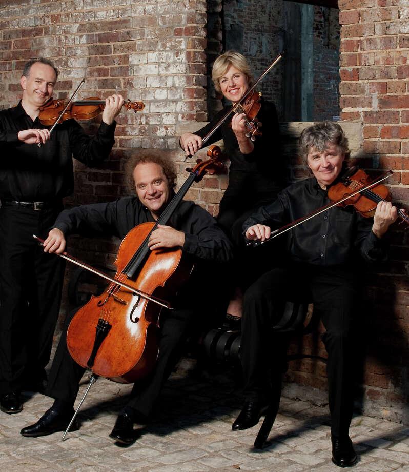 Takács Quartet is violinist Edward Dusinberre (left), cellist András Fejér, violist Geraldine Walther, violinist Károly Schranz. Photo: Cal Performances / ONLINE_YES