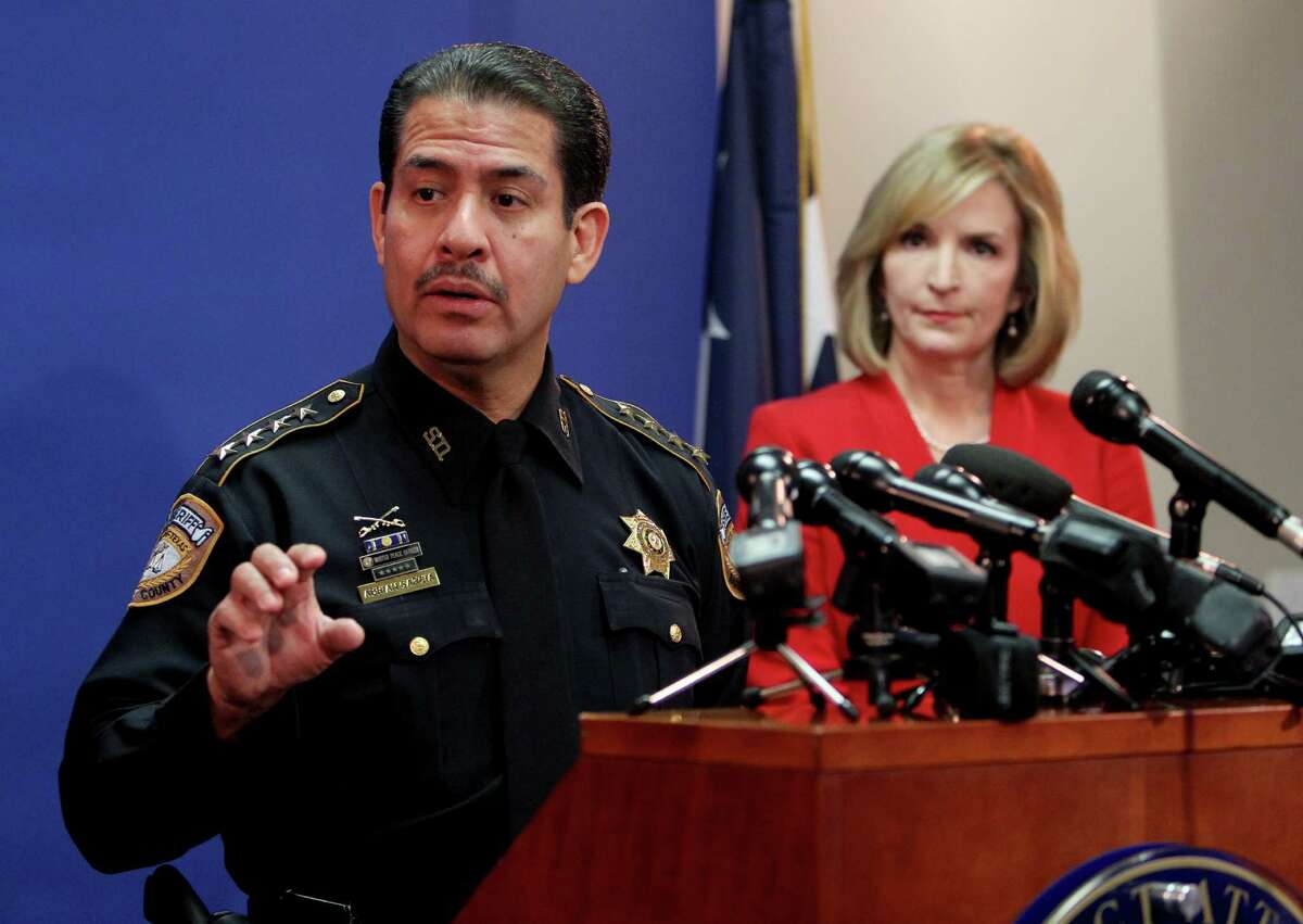 Adrian Garcia, left, Harris County Sheriff, shown with District Attorney Devon Anderson, at a news conference where Anderson announced a marijuana arrest policy on Wednesday, Oct. 1, 2014. ( Gary Coronado / Houston Chronicle )