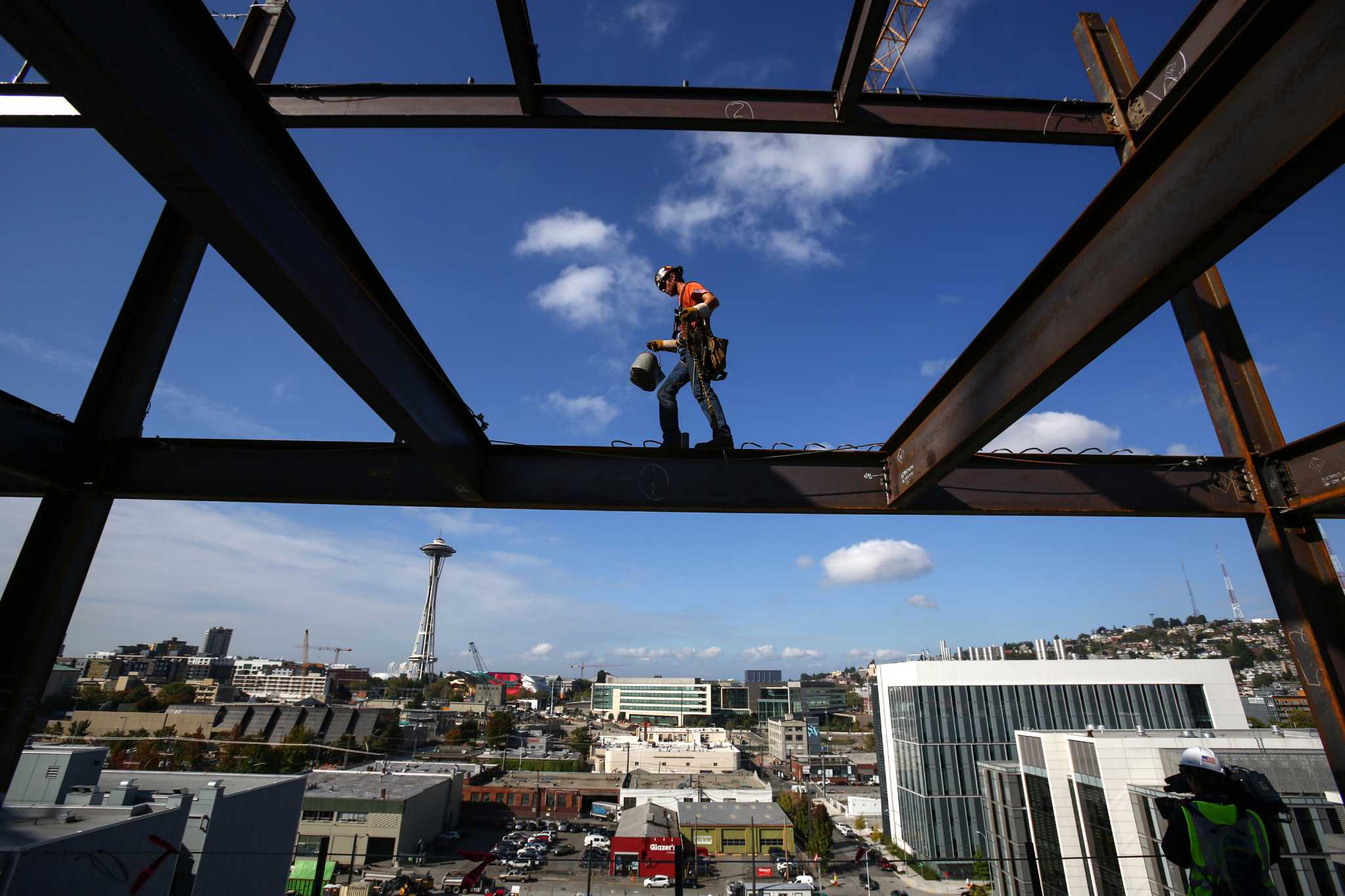 Lunch Atop a Skyscraper Photograph: The Story Behind the Famous Shot Ironworkers on beam photo