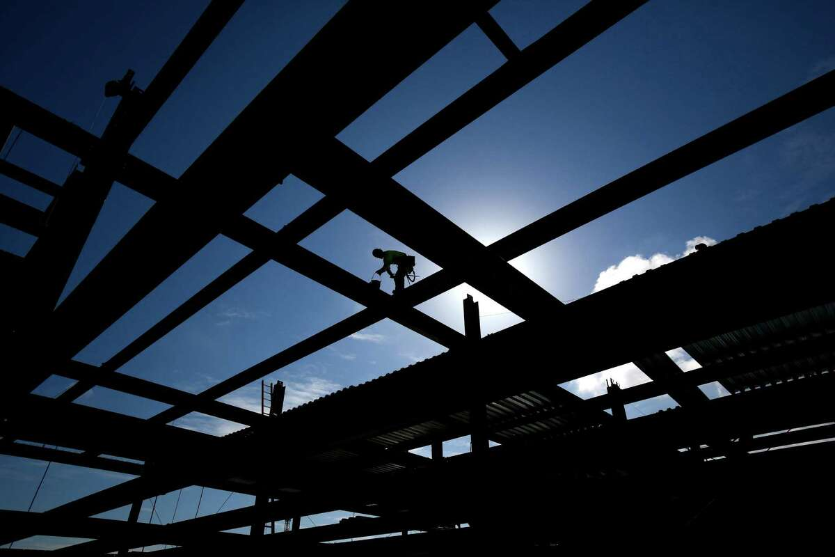 An iron worker climbs on the under-construction 12th floor of Vulcan's Block 45 Project in South Lake Union.