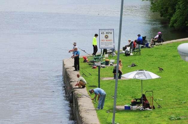 People fish along the Mohawk River near Lock 7 on Monday, May 26, 2014, in Niskayuna, N.Y.  (Paul Buckowski / Times Union) Photo: Paul Buckowski / 00027038A