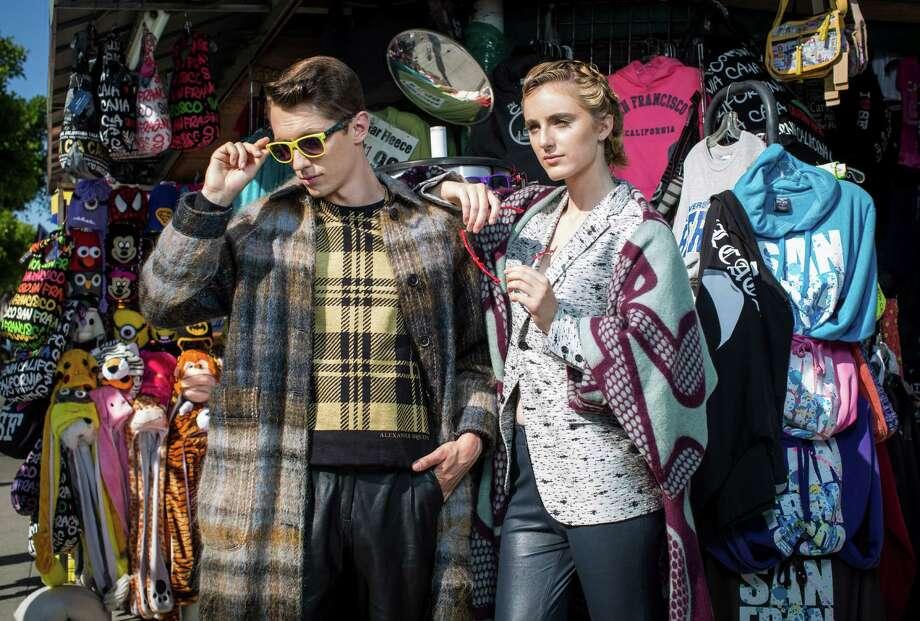 "Pattern Play: Deedee: custom windowpane jacket from Wingtip, www.wingtip.com; metallic lurex sweatshirt by Paul Smith, $525, Saks Fifth Avenue Men's Store; Comme des Garcons plaid ""vest"" scarf, $525, Modern Appealing Clothing; gray wool jogger pants by Lanvin, $1,195, Neiman Marcus. Luca: Ami Prince of Wales coat, $895, and Diesel Black Gold oil slick sweater, $495, both Saks Fifth Avenue Men's Store; Nicacelly scarf, $65, www.nicaelly.com; bias plaid Artful Gentleman slacks, $525, www.artfulgentleman.com. Photo: Russell Yip / The Chronicle / ONLINE_YES"