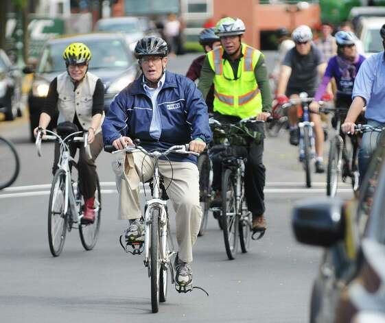 Troy Mayor Lou Rosamilia leads a group of bicyclists during the Mayor's Ride on Thursday, Oct. 2, 2014 in Troy, N.Y.  The ride was organized by Transport Troy, a citizens group dedicated to improving pedestrian and bicycle lanes throughout the city of Troy.   (Paul Buckowski / Times Union) Photo: Paul Buckowski / 00028861A