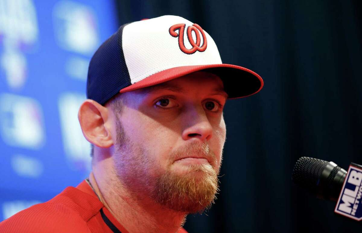 Washington Nationals starting pitcher Stephen Strasburg speaks during a media availability before a baseball workout at Nationals Park, Thursday, Oct. 2, 2014, in Washington. It was announced that Strasburg will pitch on Friday in Game 1 of the NL Division Series against the San Francisco Giants. (AP Photo/Alex Brandon)