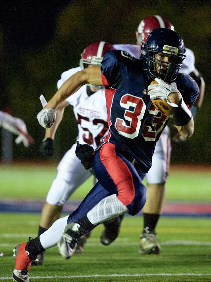 New Fairfield's Zachary Tripodi (33) runs with the ball during a football game between Bethel and New Fairfield High Schools , on Thursday, October 2, 2014, in New Fairfield, Conn. Photo: H John Voorhees III / The News-Times Staff Photographer