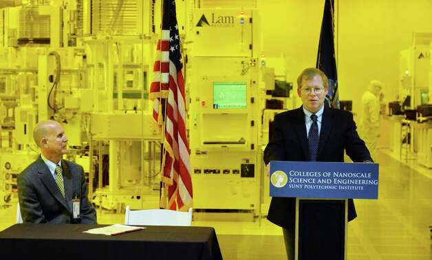 Senior vice president and CEO at SUNY Polytechnic Institute Robert Geer speaks during a signing ceremony with Dr. John Howard, left, director of the National Institute for Occupational Safety and Health outside the Lam Research clean room at the Colleges of Nanoscale Science and Engineering Thursday Oct. 2, 2014, in Albany, NY.   (John Carl D'Annibale / Times Union) Photo: John Carl D'Annibale / 00028859A