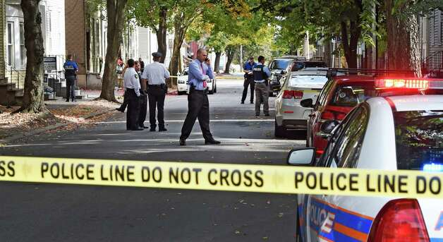 Albany police investigate a shooting on 1st Street Thursday afternoon, Oct. 2, 2014, in Albany, N.Y.  (Skip Dickstein/Times Union) Photo: SKIP DICKSTEIN