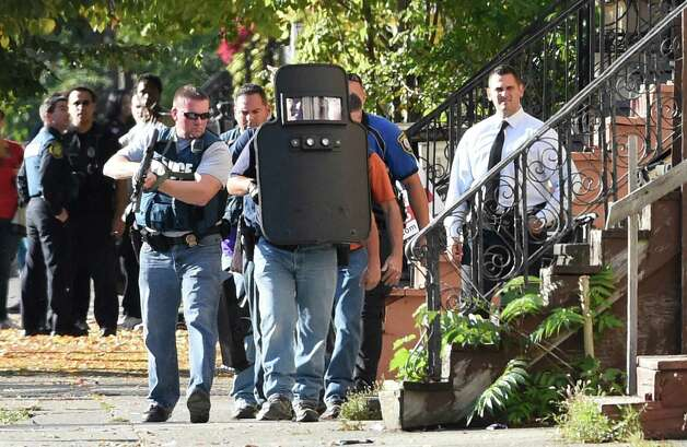 Albany Police Emergency Response Team prepare to enter 527 Clinton Avenue after is was alleged that a shooting suspect took cover inside Thursday afternoon, Oct. 2, 2014 in Albany, N.Y. (Skip Dickstein/Times Union) Photo: SKIP DICKSTEIN