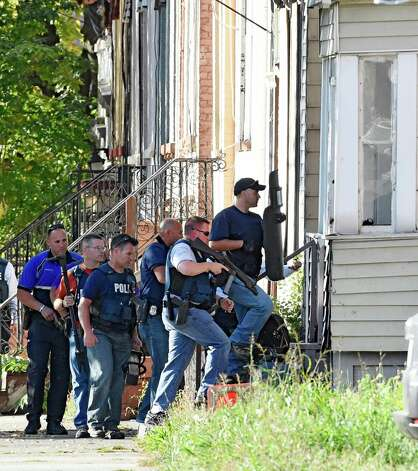 Albany Police Emergency Response Team prepare to enter 527 Clinton Avenue after is was alleged that a shooting suspect took cover inside Thursday afternoon, Oct. 2, 2014, in Albany, N.Y. (Skip Dickstein/Times Union) Photo: SKIP DICKSTEIN