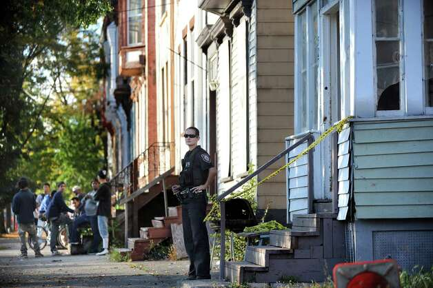 Albany Police Officer Kristen Pulcher, center, guards the entrance to 527 Clinton Ave. following a shooting on Thursday, Oct. 2, 2014, in Albany, N.Y. (Cindy Schultz / Times Union) Photo: Cindy Schultz