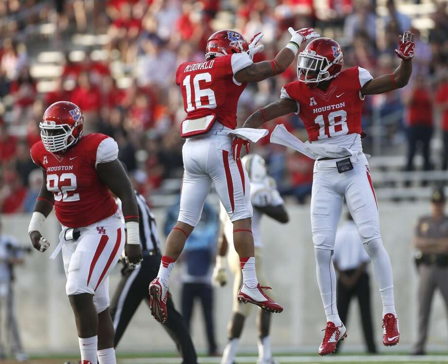Houston Cougars defensive backs Adrian McDonald (16) and Lee Hightower (18) celebrate stopping UCF Knights offense during the first half of a college football game at TDECU Stadium at the University of Houston, Thursday, Oct. 2, 2014, in Houston. ( Karen Warren / Houston Chronicle  ) Photo: Karen Warren, Houston Chronicle