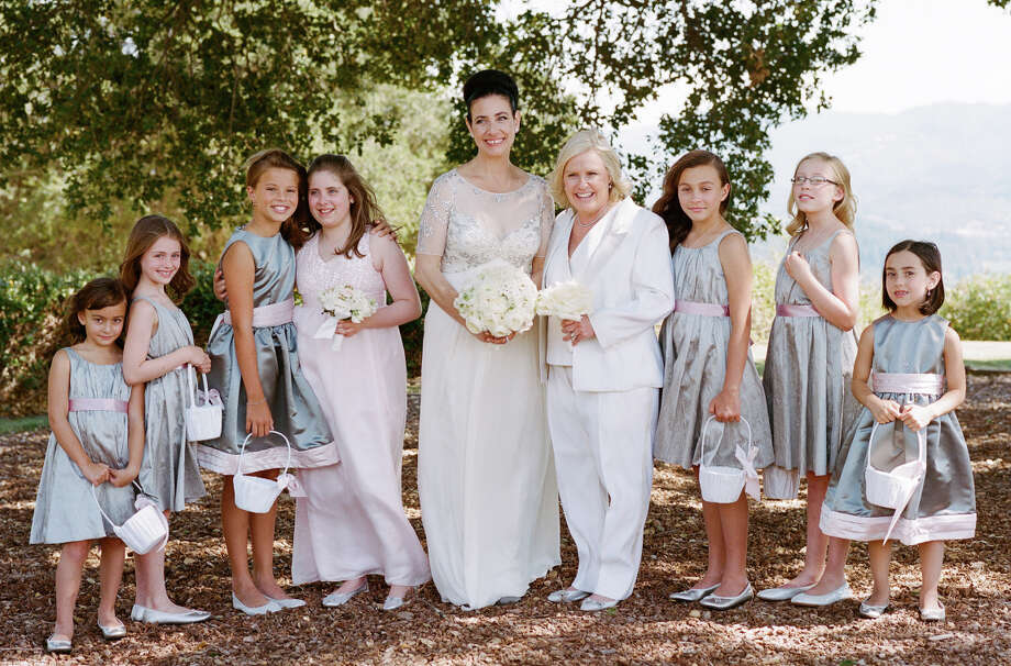 Clare Albanese (left) and Amy Errett with daughter Madison Reed (to the left of Clare) and flower girls. Photo: Meg Smith / ONLINE_YES